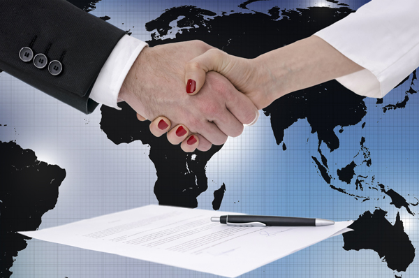 shaking hands over map